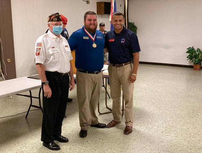 John H. McLain Veteran of the Year Award-winner Todd Hughes, center, with Christopher Kielty, left, and Carlos Moreira of the Sarasota County Veterans Commission.
