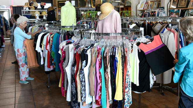 Customers shop for bargains at the Treasure Chest thrift store in 2019. The store is a component of the Safe Place and Rape Crisis Center (SPARCC) in Sarasota. Consumers have become more conscious during the COVID-19 pandemic.