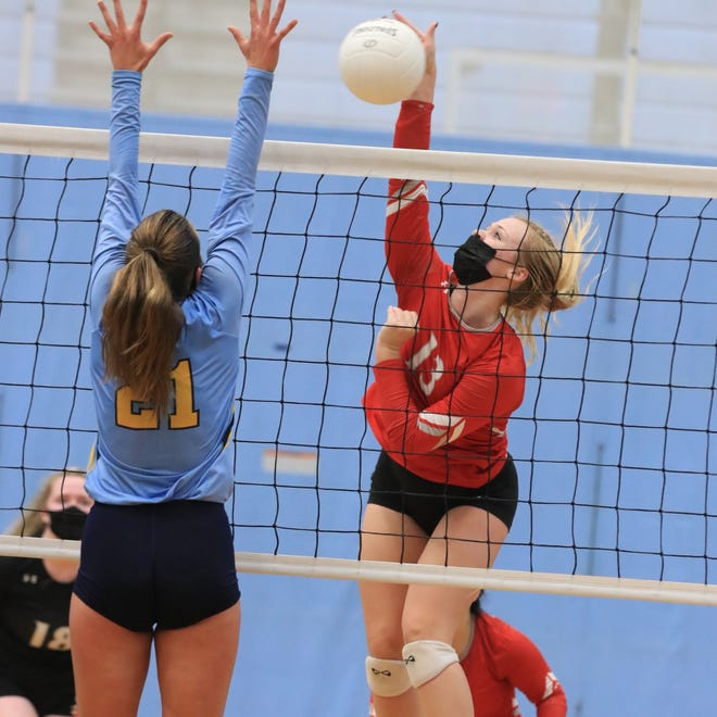 Smyrna High School volleyball player Sophia Basler hits a shot.