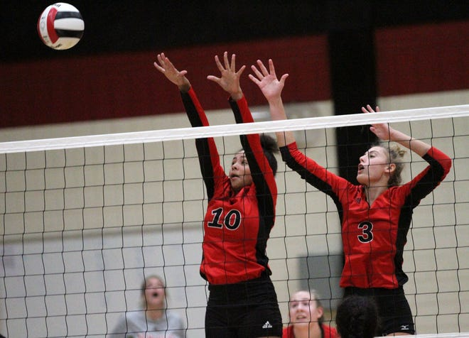 The New Bern volleyball team will be looking toward Chloe Lawrence (10) and Marlee Hanford (3) in 2020 as the Bears try to replace six seniors from last year's 17-9 team. [Gray Whitley / Sun Journal]