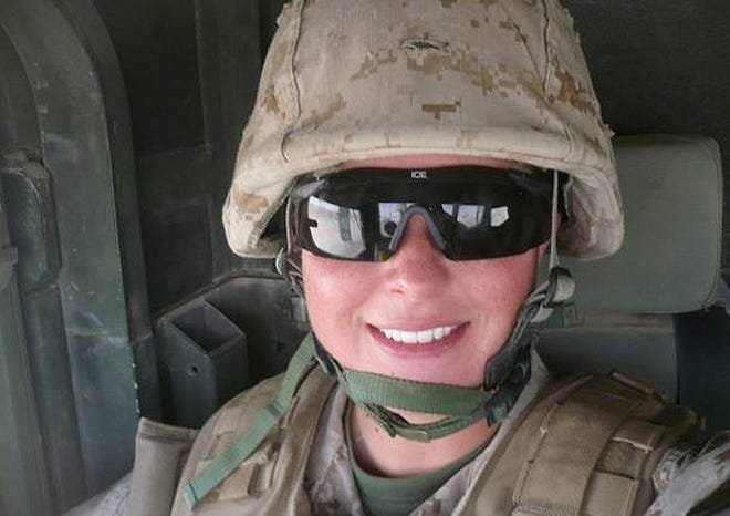 Cutline: Taryn O'Leary shown when she was an active duty Marine. She recently decided to close her Havelock business Flipped Fantasia and run it from home.