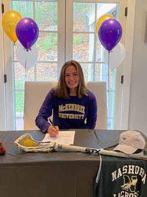 Shauna Curran signs her letter of intent to play lacrosse at McKendree University.