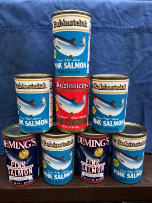 Cans of salmon donated as part of the WHEAT Salmon Run at Bolton's Holy Trinity Parish.