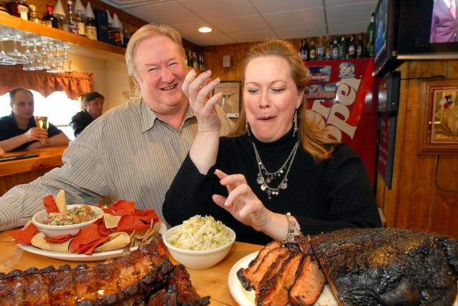 The Texas BBQ Company restaurant owners David and Linda Brannon enjoy a plate of brisket at the Northboro eatery in 2007.