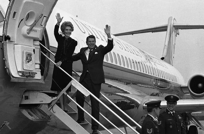 President-elect and Mrs. Ronald Reagan wave as they leave Los Angeles on Nov. 17, 1980 for Washington, D.C. where he'll have meetings in the transition of the government. It was the first time the President-elect was to use an aircraft from the presidential fleet.