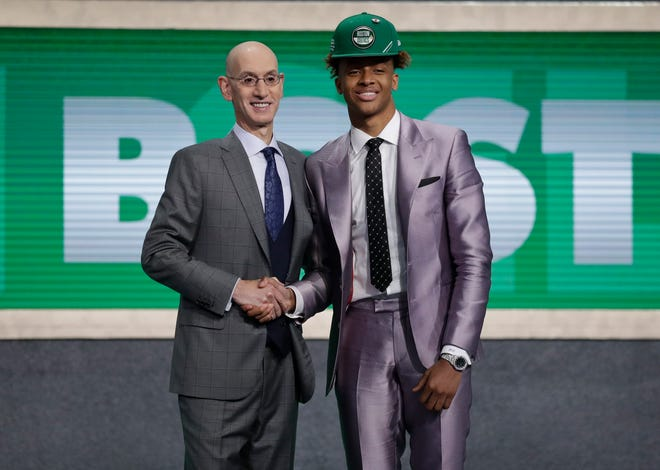 NBA Commissioner Adam Silver, left, poses for photographs with Romeo Langford after the Boston Celtics selected him as the 14th pick overall in last year's NBA Draft.