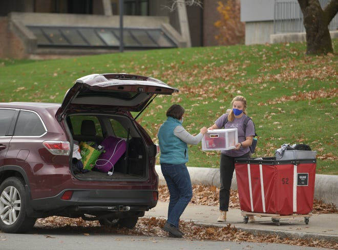 Cordie Southall of Freeport, Maine, helps her daughter, Robbie, 18, pack their car for the move home from campus on Monday, Nov. 15.