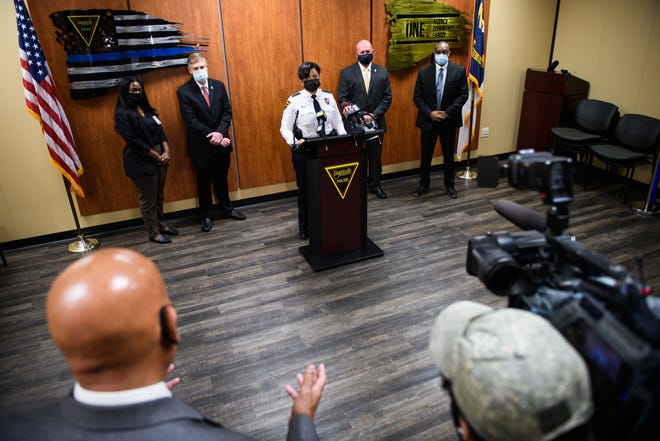 Reporters ask Fayetteville Police Chief Gina Hawkins questions during a news conference at which officials announced an arrest in an unsolved 1992 kidnapping and sexual assault.