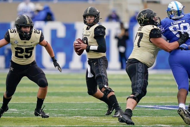 Vanderbilt quarterback Ken Seals scrambles during the second half Saturday against Kentucky in Lexington, Ky.