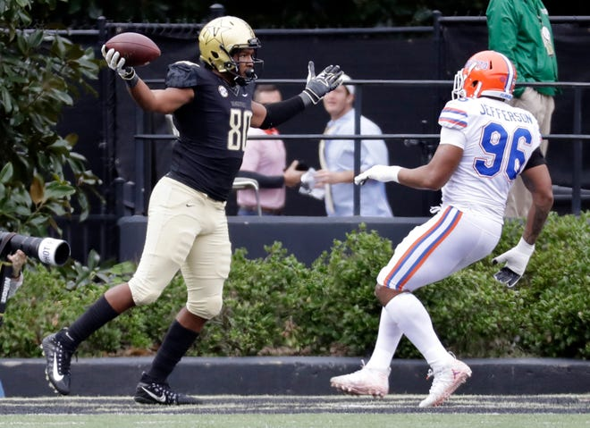 Vanderbilt tight end Jared Pinkney celebrates after scoring a touchdown ahead of Florida defensive lineman Cece Jefferson in the first half of the Oct. 13, 2018 game in Nashville, Tenn. The Gators trailed 21-3 before winning 37-27.