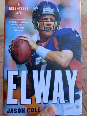 Gainesville writer Jason Cole's book on former Denver Broncos quarterback John Elway.
