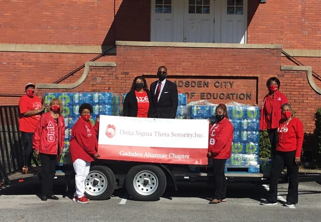 Members of the Delta Sigma Theta sorority presented Gadsden City Schools Superintendent Tony Reddick with a donation of 800 cases of bottled water for students Friday.