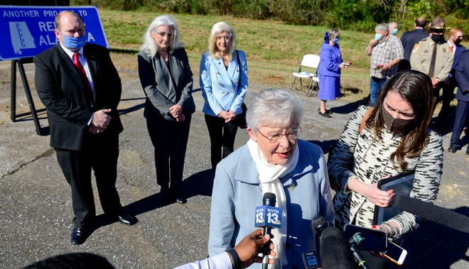 Gov. Kay Ivey speaks to members of the media as Sen. Andrew Jones, Rep. Ginny Shaver and Rep. Becky Nordgren look on following a groundbreaking ceremony for the widening of U.S. Highway 411 near Leesburg on Monday, Nov. 16, 2020.