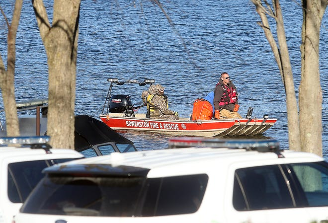 The rescue boat from Bowerston Fire and Rescue comes back in at the Clendening Lake Marina Monday afternoon after searching the lake for missing hunters.