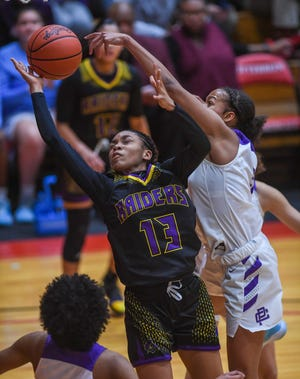 Reynoldsburg's Jamiona Ross drives to the basket against Pickerington Central during last season's Division I regional semifinal. The Raiders expect to reach that level again this winter thanks to a talented returning cast that has been boosted by a trio of transfers.