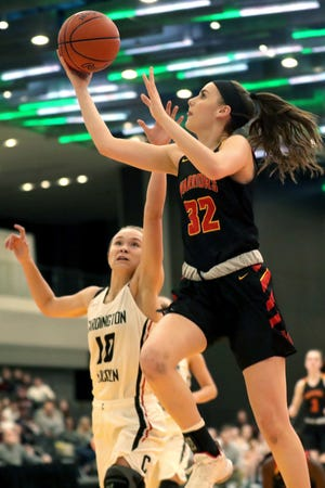 Worthington Christian's Katherine Weakley drives to the basket during a Division III district final last season. The Warriors hope to reach at least that level this winter behind Weakley, a 5-foot-11 senior who will play college basketball at Lipscomb.