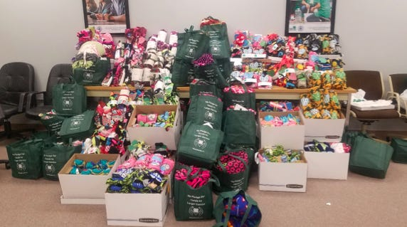 Sunny Side Up 4-H Club, led by Suzanne Sarro, participated in the Plymouth County 4-H Community Service Project creating scarf sets and blanket sets for the homeless.