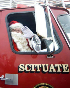 The late Joe Norton reveled in playing Santa Claus as part of Scituate's Christmas celebration.  Scituate Community Christmas is dedicating its Big Community GIVE:  Season of Giving to him. [Courtesy photo]