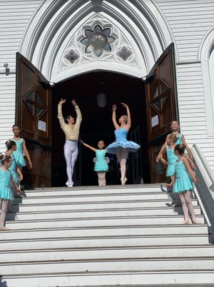 On location at St. Paul's Church, Hingham. Pictured from left: Palace Fairies Sabrina Niblack, age 9, of Norwell; Evangeline Scheid, age 8, of Norwell; Enya Teran, age 8, of PlymptonCenter. Center: Harry Yamakawa-Moser as Cavalier, age 38, of Winchester; Claire Buchholz as Palace Fairy, age 7, of Quincy; Olivia Boutin as Sugar Plum, age 18, of Plymouth. Right: Palace Fairies Noelle Hess, age 7, of Cohasset; Estella Emgdahl, age 8, of Hingham; Gwendolyn Demasi, age 7, of Hingham.