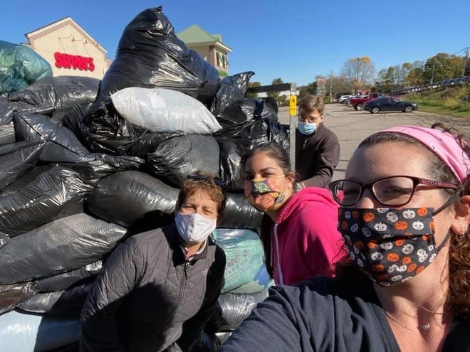 Pictured, from left, are Marlborough Junior Woman's Club members Elizabeth Cogliano Young, Theresa Haddad Frias and Justine Craven-Goetz, who collected items from members and delivered them to Savers for a fundraiser to benefit the Metrowest Princess Boutique.