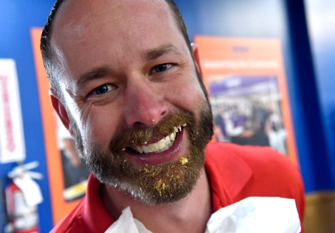 With pie in his beard, Wesley Gosdin stands after winning the pie-eating contest at the South 14th Street location of United Supermarkets on Friday.