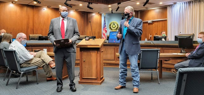 Mayor Anthony Williams and Place 4 Abilene City Council member Weldon Hurt address well-wishers at their swearing-in ceremony Monday.