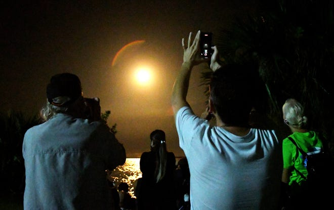 Spectators near Titusville watch the takeoff of the SpaceX Crew-1 mission last Sunday.