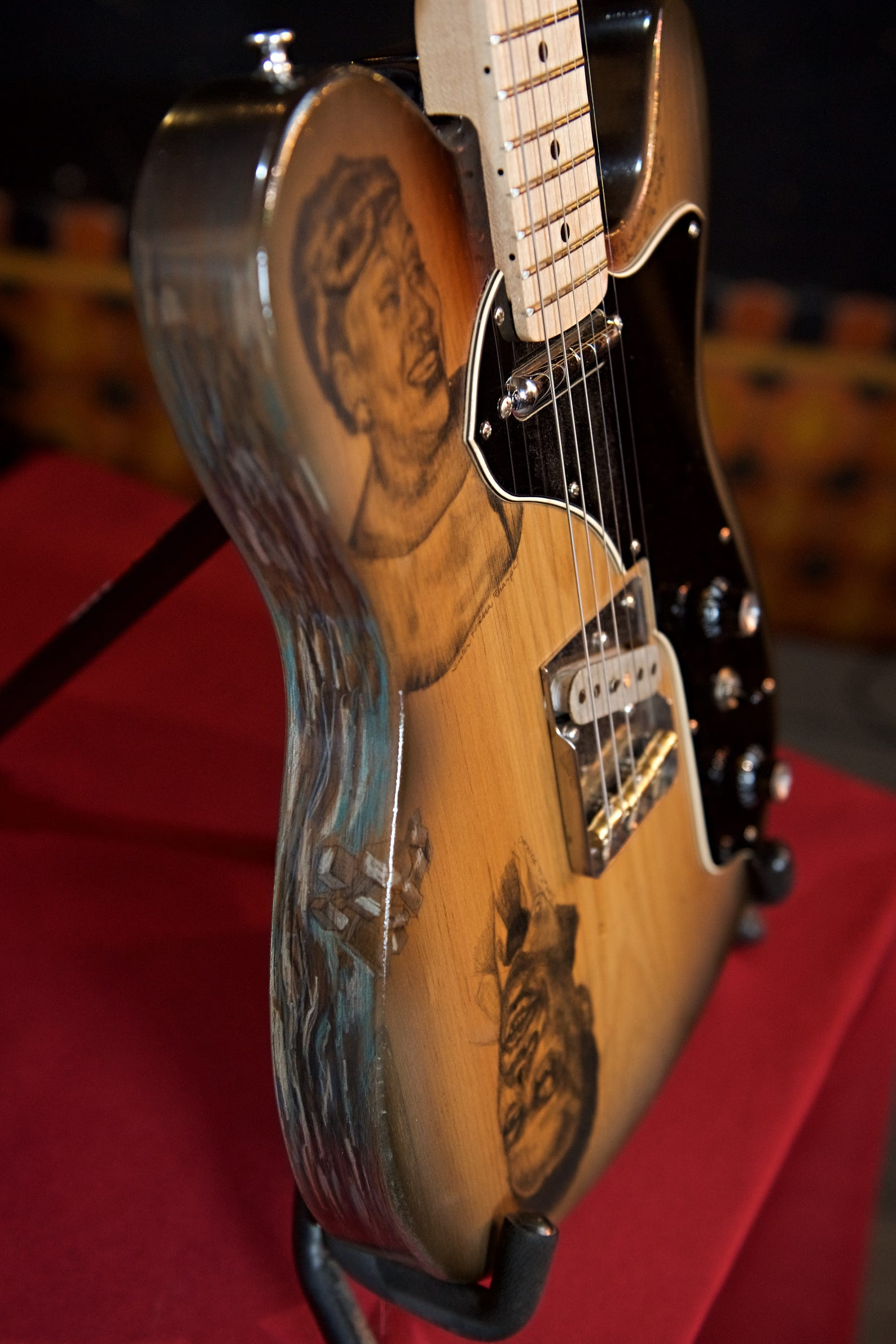 Gabriel Currie recently donated this handmade guitar to WDET that is being raffled to make money for the public radio station. It was built using wood from northern Michigan trees that were submerged in a lake for 100 years. Sabrina Nelson, a Detroit multimedia artist, created custom artwork featuring famous guitarists that adorns the front and back of the instrument. It is on display at the Detroit Historical Museum until National Guitar Day, Jimi Hendrix's birthday, on Nov. 27.