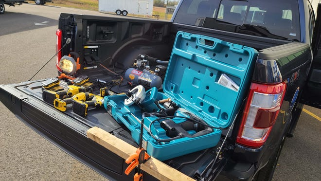 Option the 2021 Ford F-150 Hybrid's 7.2 kW onboard generator and the truck is a rolling work space that can power multiple tools.
