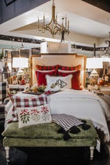 For those who like to keep their duvet consistent through the changing of the seasons, plaid accents are a great way to bring a touch of holiday to your space.
