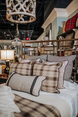 Houndstooth, tartan and animal print – oh my what a lovely trio! Neutral plaids can bring just as much to a room as their colorful cousins. (Handout/TNS)