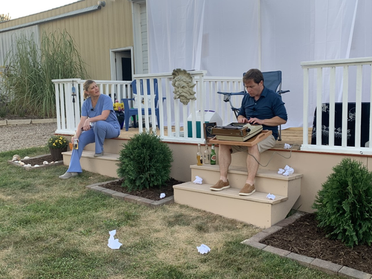 """Nicole DeSalle and Jocko Motyko in Trent Yoder's backyard performing a play of DeSalle's creation, """"Oscar.""""  Though originally written, staged and recorded over the Spring/summer of 2020, the show will be streamed as part of Iowa City Community Theatre's season in light of the COVID-19 pandemic."""