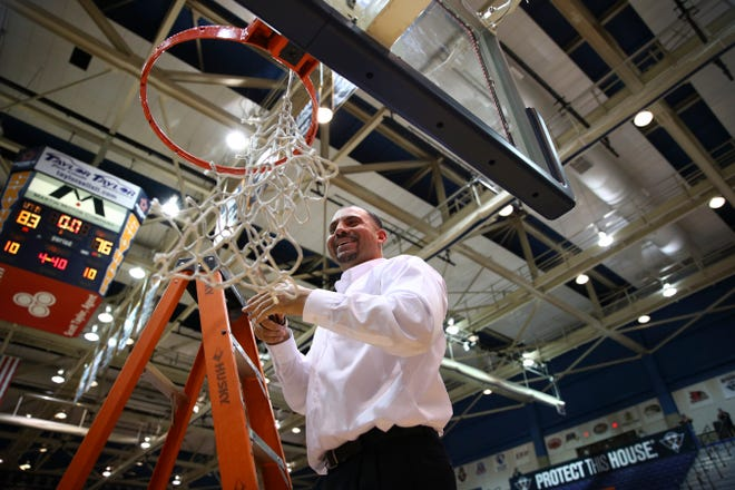Anthony Stewart cuts down the net after securing a regular season Ohio Valley Conference division title at UT Martin in his first season leading the team.