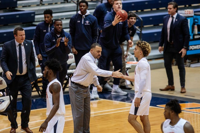 UT Martin head coach Anthony Stewart gives his son, Parker, five as the team comes to the bench for a timeout during a game last year. Anthony Stewart died on Sunday at 50 years old.