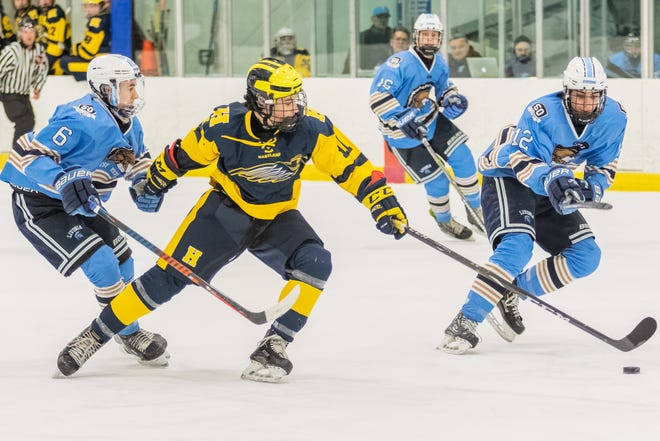 Senior Seth Ferguson (11) and his Hartland hockey teammates are coping with another shutdown of winter sports because of COVID-19.