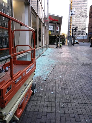 Broken glass was strewn all over the sidewalk outside the Brown and Williamson Tower at 4th and Liberty Streets in Louisville, Ky. on Nov. 16, 2020.  The windows were replaced recently after being vandalized, and now someone has broken the new windows.