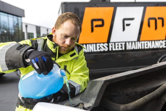 Drake Tulloh, 31, works on a vehicle as owner of the company, Painless Fleet Maintenance. The mobile business provides reapirs and maintenance for fleets.
