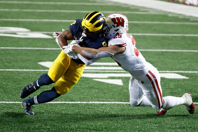 Wisconsin safety Eric Burrell brings down Michigan running back Chris Evans on Saturday night.