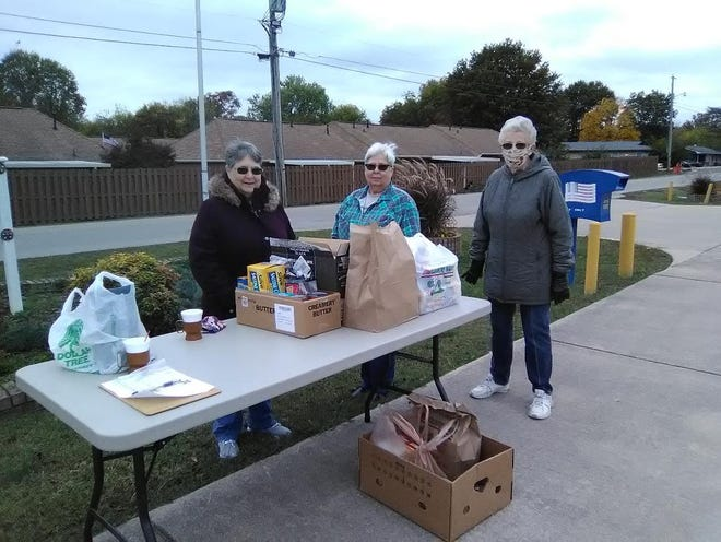 On Saturday, Oct. 24, Alley-White American Legion Auxiliary Unit 52 in Mountain Home held a drive-thru food drive for Make a Difference Day. Members collected soup and crackers of all kinds to donate to the Mountain Home Food Basket, and collected a total of 375 pounds of food and about $175 in cash donations.  Shown above are Auxiliary members Karen Mikulewicz, Debbye Barreda and Kay Owens.