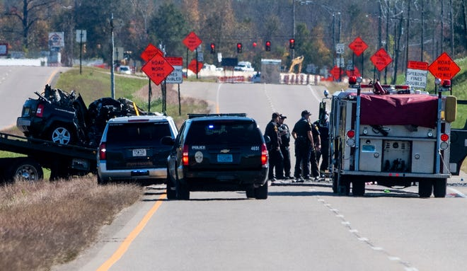 Emergency crews clean up the scene of a fatal vehicle accident on Troy Highway near Perimeter Parkway in Montgomery, Ala., on Monday morning November 16, 2020.