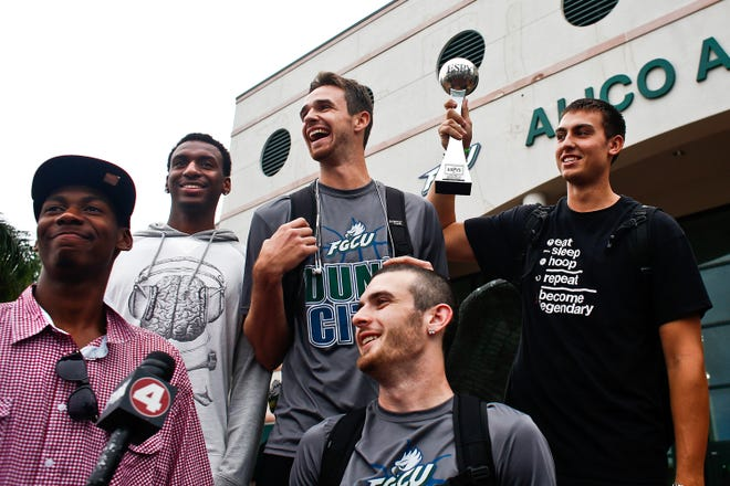 FGCU players from left, Eric McKnight, Bernard Thompson, Eddie Murray, Brett Comer, and Chase Fieler thank their fans and supporters after returning to FGCU after winning Biggest Upset award in the 2013 ESPYS Awards in Los Angeles.