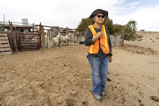 Navajo archaeologist Rena Martin at the sheep pens by a home where she's doing surveying work.