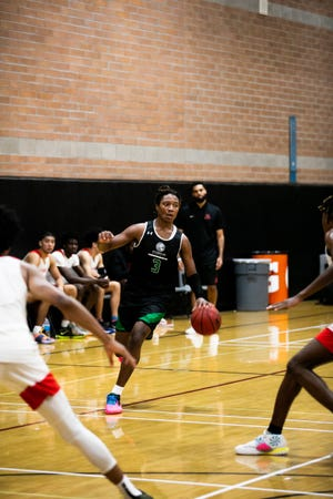 Oct. 25, 2020; Arizona Compass Prep boys basketball guard TyTy Washington runs the Dragons offense against Dream City Christian in the Border League's West Coast division championship game.