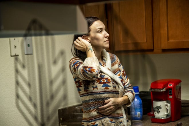 Mary Gomez, 32, a mother of four, makes breakfast while her children attend virtual school at their apartment in Mesa, Arizona.