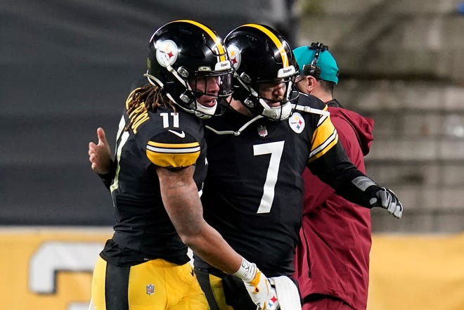 Pittsburgh Steelers wide receiver Chase Claypool (11) celebrates with quarterback Ben Roethlisberger after the two connected on an 11-yard pass play for a touchdown during the second half of an NFL football game against the Cincinnati Bengals, Sunday, Nov. 15, 2020, in Pittsburgh. (AP Photo/Keith Srakocic)