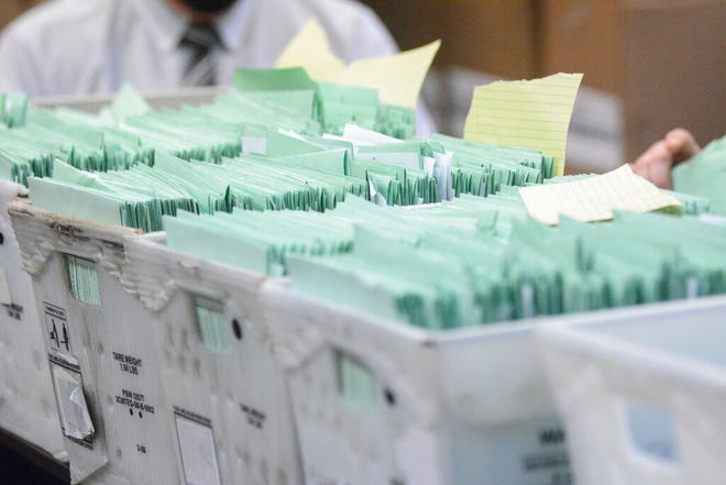 Uncounted provisional ballots sit in boxes at the Schuylkill County Election Bureau in Pottsville, Pa. on Tuesday, Nov. 10, 2020. (Lindsey Shuey/The Republican-Herald via AP)