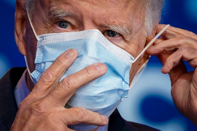 Democratic presidential nominee Joe Biden puts on his face mask after making remarks about the Affordable Care Act and COVID-19 after attending a virtual coronavirus briefing with medical experts at The Queen theater on October 28, 2020 in Wilmington, Delaware. (Drew Angerer/Getty Images/TNS)