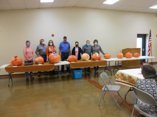 The 7th annual Pumpkin Festival in San Angelo was on Nov. 7, 2020. Pictured are, from left, Robin Dehnel, second place; Ann Follis, first place; Patrick Dierschke, Joy Shelton, and Mr. and Mrs. Elliot Daniel showing for Henry Broadnax, third place.