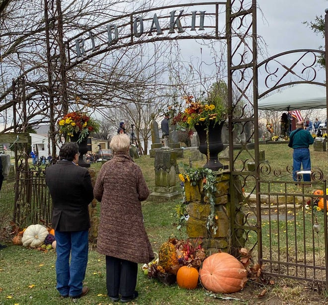 Following the formal memorial ceremony for Lowell Davis, visitors were invited inside the fence surrounding the cemetery to lay flowers on the gravesite.