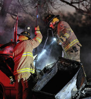 Wichita Falls firefighters worked to control an early morning vehicle fire Monday on Martin Luther King Jr. Boulevard.